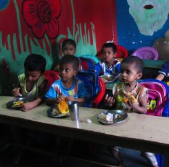 The children eating their breakfast at the school.